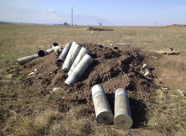 Cartridges of artillery shells are seen at the trenches near Starobesheve, controlled by pro-Russian separatists, in eastern Ukraine October 2, 2014. (Photo by Maria Tsvetkova/Reuters)