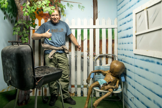 Chris has fun with one of the exhibits. (Photo by Chris Burton/Caters News Agency)