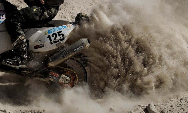 KTM rider Ferdinand Kreidl of Austria kicks up dust on his way up a mountain during the 4th stage. (Photo by Victor R. Caivano/Associated Press)
