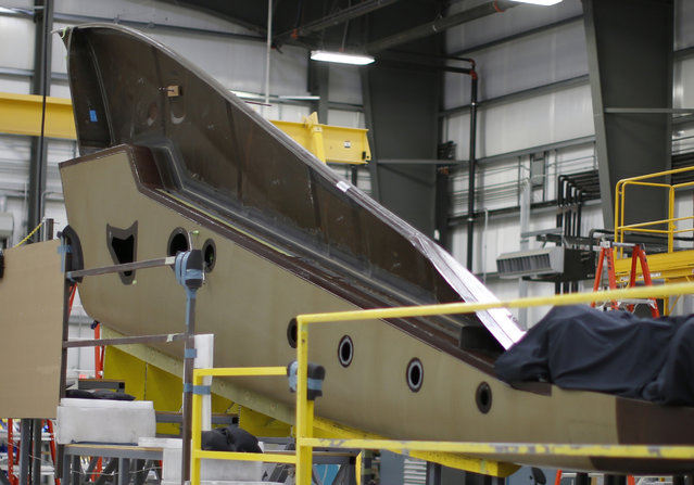 The tail of Virgin Galactic's new spaceship N202VG, which the company began building 2 and a half years ago, is seen in a hangar at Mojave Air and Space Port in Mojave. (Photo by Lucy Nicholson/Reuters)