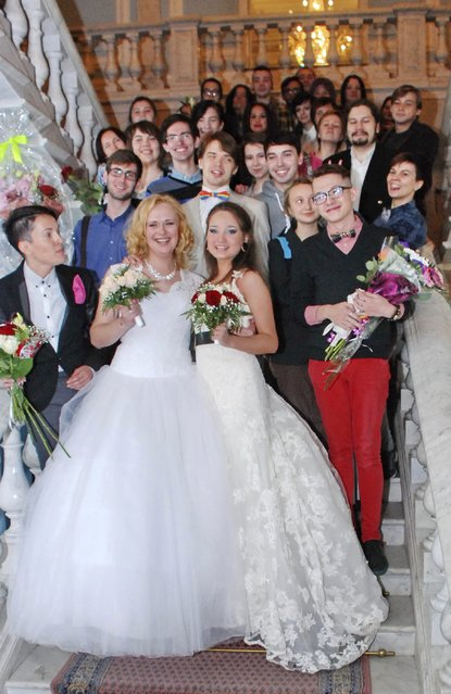 Two brides pose with their guests after their wedding ceremony to each other at the wedding registry office in St. Petersburg November 7, 2014. (Photo by Reuters/Stringer)