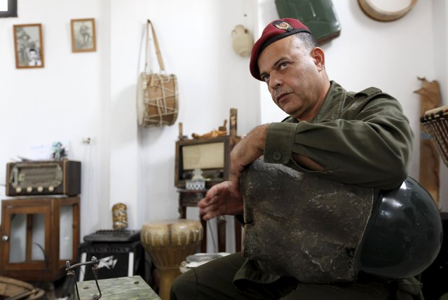 Tunisian Army retiree Belgacem Majri plays music with homemade musical instruments that he built using arms such as bombs and missiles, in Tunis, Tunisia October 20, 2015. (Photo by Anis Mili/Reuters)