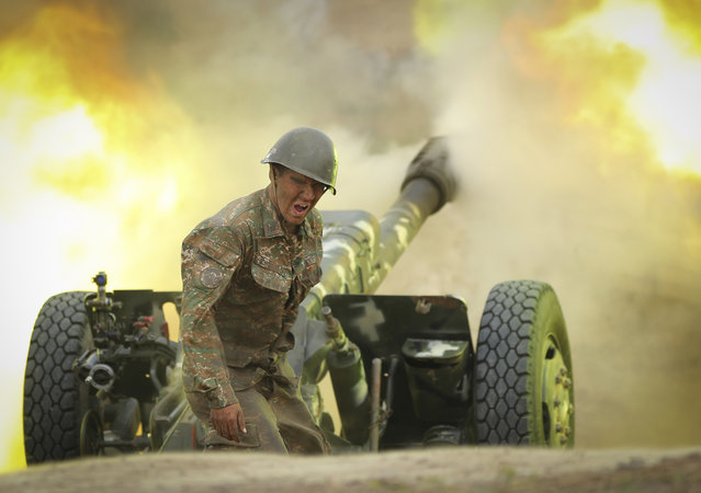 An Armenian serviceman fires a cannon towards Azerbaijan positions in the self-proclaimed Republic of Nagorno-Karabakh, Azerbaijan, Tuesday, September 29, 2020. (Photo by Sipan Gyulumyan/Armenian Defense Ministry Press Service/PAN Photo via AP Photo)