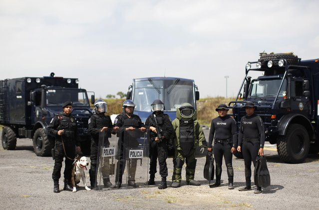 "Members of the Task Force for Mexico City pose for a photograph at their base in Mexico City October 15, 2014. In Mexico, ""when violent action by a crowd cannot be deterred, a scale of force will be applied progressively consisting of 1. verbal persuasion or deterrence 2. reduced physical movements 3. use of non-lethal incapacitating weapons, and 4. use of firearms or lethal force"". (Photo by Claudia Daut/Reuters)"