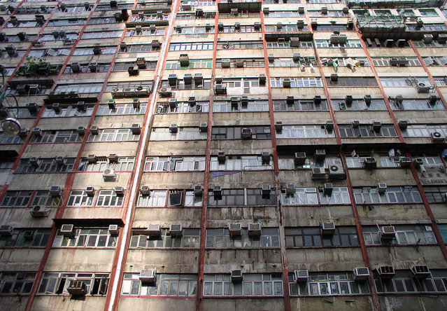 "Facade of the infamous Chungking Mansions, Hong Kong's ""mmigrant ghetto"". (Photo by Tom Carter/The Atlantic)"