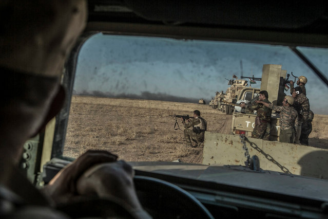 Peshmerga forces shoot as they take part in an operation to liberate several villages currently under the control of the Islamic State southeast of Mosul, north Iraq, 14 August 2016. The operation aims to recapture 11 villages, according to sources thus far six were successfully retaken with the help of US-led air support. The liberation of the villages from Islamic State forces serves as a buffer zone to protect Kurdish held-cities from IS attacks and is a stepping stone to eventually recapture the city of Mosul itself. (Photo by Andrea Dicenzo/EPA)