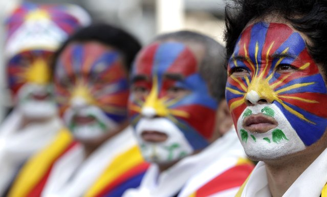 Activists with the colours of the Tibetan flag painted on their faces take part in a rally to support Tibet in Taipei March 10, 2013. Hundreds of Tibetans and their supporters in Taiwan marched the streets to commemorate the uprising in Lhasa 54 years ago against Chinese rule. (Photo by Pichi Chuang/Reuters)