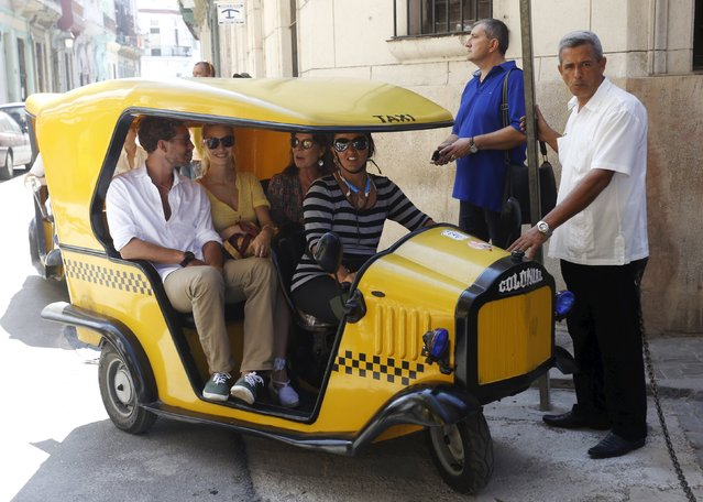 Pierre Casiraghi (L), his wife Beatrice Borromeo Casiraghi (C) and his mother Princess Caroline of Hanover sit in a coco taxi in Havana, October 29, 2015. Princess Caroline of Hanover is in Cuba to attend the performance of the Les Ballets de Monte-Carlo during the XVI Havana Theater Festival, according to local media. (Photo by Reuters/Stringer)