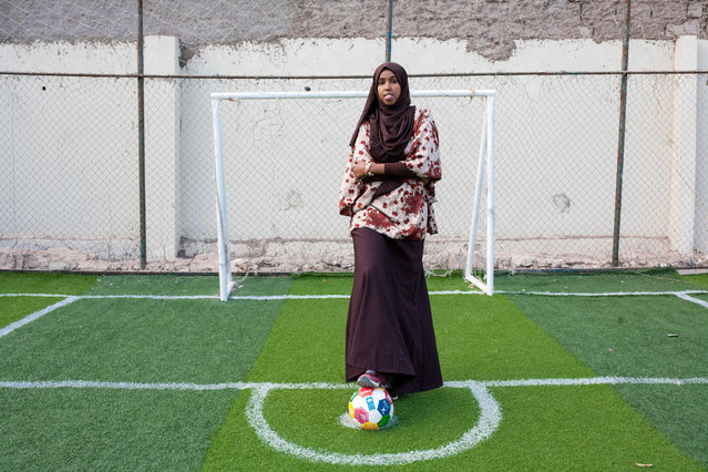 Somali football coach and player Marwa Mauled Abdi, 24, poses at the football ground of Ubah fitness center, the first football field exclusively opened for women, in Hargeisa, the capital of Somaliland, northwestern Somalia, on March 1, 2018. (Photo by Mustafa Saeed/AFP Photo)