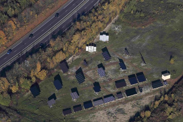 An aerial view shows solar panels of the experimental photovoltaic power plant LumiWatt at the foot of the 11/19 pit and twin slag heaps at the former coal mine site in Loos-en-Gohelle, northern France, November 1, 2015. (Photo by Pascal Rossignol/Reuters)