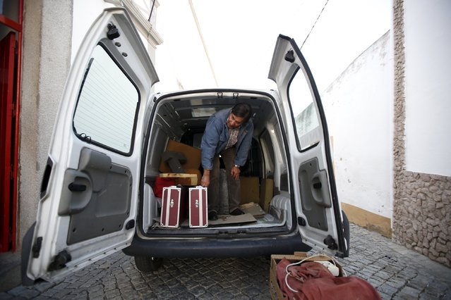 Projectionist Antonio Feliciano, 75, unloads equipment before a projection in Monforte, Portugal May 16, 2015. (Photo by Rafael Marchante/Reuters)