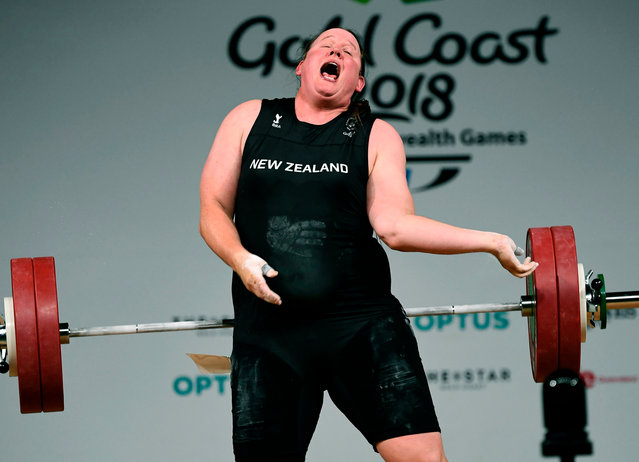 Laurel Hubbard of New Zealand reacts after injuring her arm during the women's +90 kg weightlifting final at the 2018 Gold Coast Commonwealth Games in Gold Coast on April 9, 2018. (Photo by William West/AFP Photo)