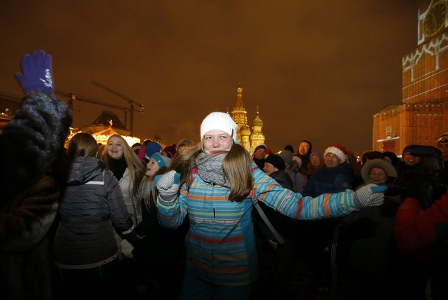 Revellers celebrate ahead of New Year's Day in Red Square in Moscow December 31, 2014. (Photo by Tatyana Makeyeva/Reuters)