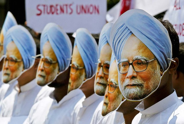 Activists wear masks of Indian Prime Minister Manmohan Singh during a protest against Singh, claiming he has not done anything for the state of Assam, where he was nominated from, in Gauhati, India, on May 15, 2013. (Photo by Anupam Nath/Associated Press)