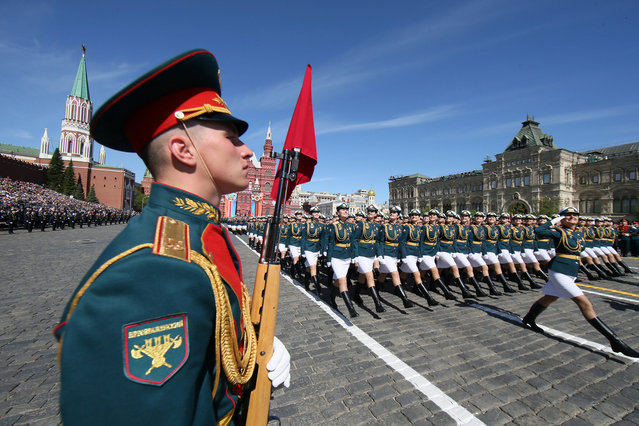 Russian servicewomen march during the Victory Day parade, marking the 73rd anniversary of the victory over Nazi Germany in World War Two, at Red Square in Moscow, Russia May 9, 2018. (Photo by Maxim Shipenkov/Reuters)