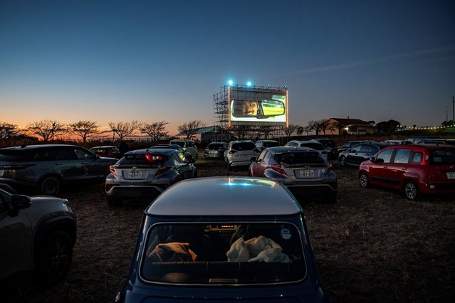 Visitors sit in their cars at a drive-in cinema at Nagai Seaside Park in Yokosuka, Kanagawa prefecture, south of Tokyo, on December 26, 2020. (Photo by Philip Fong/AFP Photo)