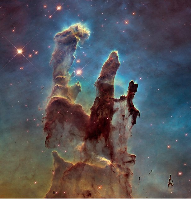 """A Hubble telescope photograph of the iconic Eagle Nebula's """"Pillars of Creation"""" is seen in this NASA image released January 6, 2015. (Photo by Reuters/NASA/ESA/Hubble Heritage Team)"""