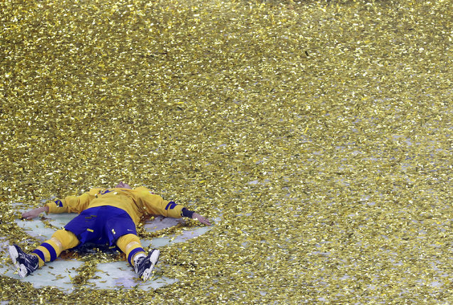 Sweden's Hampus Lindholm celebrates after winning the Ice Hockey World Championships final match between Sweden and Switzerland at the Royal arena in Copenhagen, Denmark, Sunday, May 20, 2018. (Photo by Petr David Josek/AP Photo)