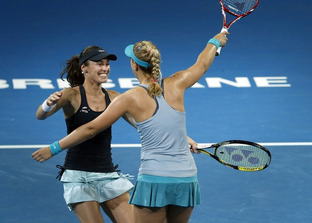Martina Hingis (L) of Switzerland and Sabine Lisicki of Germany embrace after winning their women's doubles final match at the Brisbane International tennis tournament in Brisbane, January 10, 2015. (Photo by Jason Reed/Reuters)