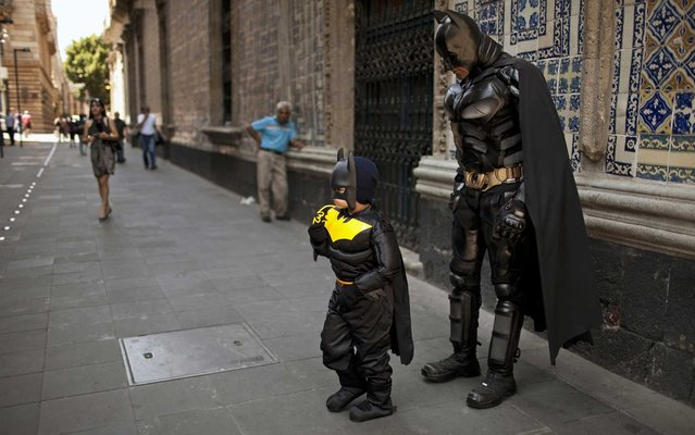 Santiago Gomez, almost 6, received an early birthday gift from his parents – a Batman costume – plus he got to hang out with a Dark Knight street performer in downtown Mexico City, on June 7, 2013. Birthdays don't get much better than that. (Photo by Ivan Pierre Aguirre/Associated Press)