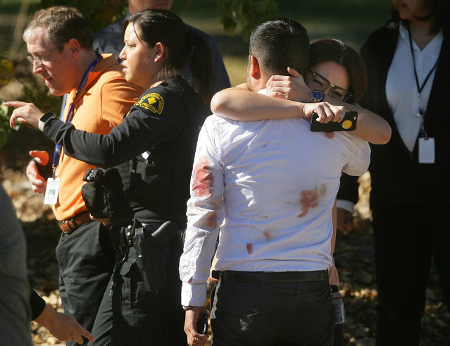 December 2, 2015 - San Bernardino, California, U.S - A couple embraces following a shooting rampage that killed at least 14 people and wounded others at Inland Regional Center, a facility for people with developmental disabilities. (Photo by David Bauman/Press-Enterprise via ZUMA Wire)