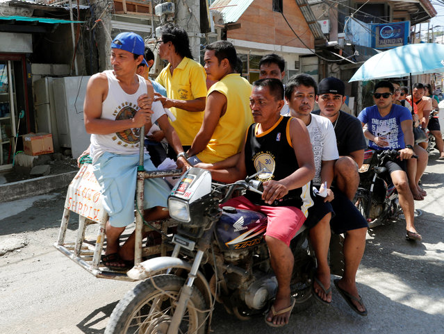 Workers who were cut off from their jobs due to the temporary closure of the holiday island Boracay, ride on a tricycle in the Philippines April 25, 2018. (Photo by Erik De Castro/Reuters)