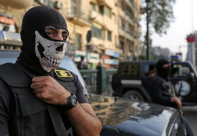 A masked member of security forces is pictured as they secure Tahrir Square in Cairo, Egypt, November 11, 2016. (Photo by Mohamed Abd El Ghany/Reuters)