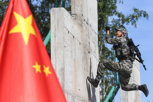 A serviceman of the Chinese People's Liberation Army (PLA) during the Scout Trail obstacle course, a stage of the Army Scout Masters competition among reconnaissance units, as part of the 2018 International Army Games at the Koltsovo range in Novosibirsk region, Russia on August 1, 2018. (Photo by Kirill Kukhmar/TASS via Getty Images)