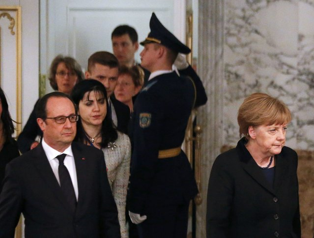 Germany's Chancellor Angela Merkel (R) and France's President Francois Hollande (L, front) walk as they attend a peace summit to resolve the Ukrainian crisis in Minsk, February 12, 2015. (Photo by Vasily Fedosenko/Reuters)