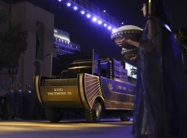 A convoy of vehicles transporting royal mummies is seen in Cairo, Egypt, Saturday, April 3, 2021. Egypt held a parade celebrating the transport of 22 of its prized royal mummies from Egyptian Museum to he newly opened National Museum of Egyptian Civilization. (Photo by Samah Zidan/AP Photo)