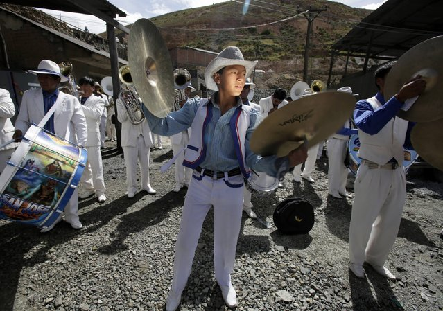 Musicians perform at the Itos (Nueva San Jose) silver and base metals mine during a celebration in the outskirts of Oruro, February 13, 2015. Every year, on the Friday before the Andean carnival celebrations, miners sacrifice animals in the mine to bless it, pray for their well-being and to give thanks to Mother Earth. (Photo by David Mercado/Reuters)