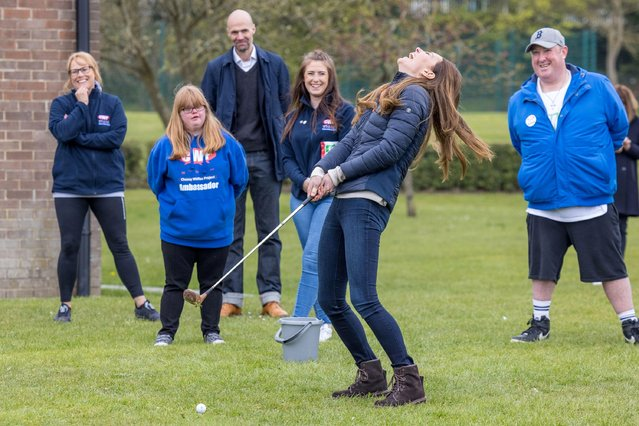 Britain's Catherine, Duchess of Cambridge plays a stroke of golf during a visit to meet young people supported by the Cheesy Waffles Project, a charity for children, young people and adults with additional needs across County Durham, at the Belmont Community Centre, in Durham, north east England on April 27, 2021. (Photo by Andy Commins/Pool via AFP Photo)