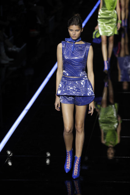 A model wears a creation as part of the Emporio Armani women's 2019 Spring-Summer collection, unveiled during the Fashion Week in Milan, Italy, Thursday, September 20, 2018. (Photo by Luca Bruno/AP Photo)