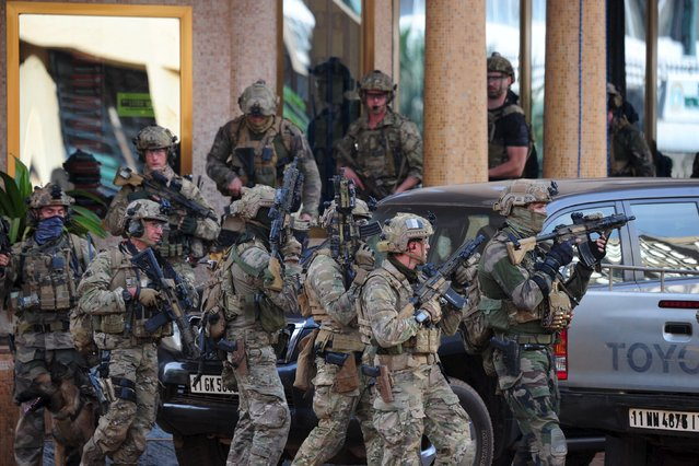 French soldiers arrive at the site of the attack in Ouagadougou, Burkina Faso, January 16, 2016. (Photo by Reuters/Stringer)