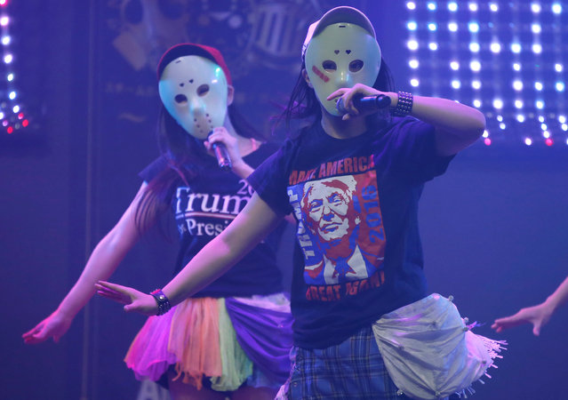 Members of Japanese idol group Kamen Joshi (Masked Girls) in attires featuring images or names of U.S. President-elect Donald Trump, perform during their concert at their theatre in Tokyo's Akihabara district, Japan, December 12, 2016. (Photo by Toru Hanai/Reuters)