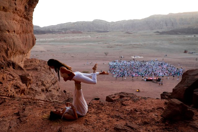 Yogis, Israeli and foreigners, participate in the Arava Yoga Annual festival at the ancient copper mines area of the Timna Valley, in the southern Arava region of Israel, north of Eilat on November 2, 2018. (Photo by Menahem Kahana/AFP Photo)