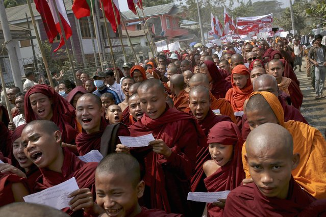 Thousands of Rakhine Buddhists are led by monks in a protest against allowing white card holders to vote in the upcoming general elections, in Sittwe February 15, 2015. Myanmar's decision to revoke temporary identification cards for minorities is raising tensions among its 1.1 million Rohingya Muslims, who have effectively been disenfranchised just days after parliament approved a law affirming their right to vote in a referendum. (Photo by Reuters/Minzayar)