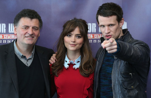 """Actors Matt Smith (R), who plays """"Doctor Who"""", and Jenna Coleman, who plays  """"Clara Oswald"""", in the science fiction series """"Doctor Who"""" pose for a photograph with Steven Moffat (L), the series writer, at the """"Doctor Who 50th Celebration"""" event in the ExCeL centre on November 22, 2013 in London, England. The sold-out three day event in the ExCeL London convention centre celebrates 50 years of the show which has seen 11 actors play the role of Doctor Who and receives a worldwide cult following. (Photo by Oli Scarff/Getty Images)"""