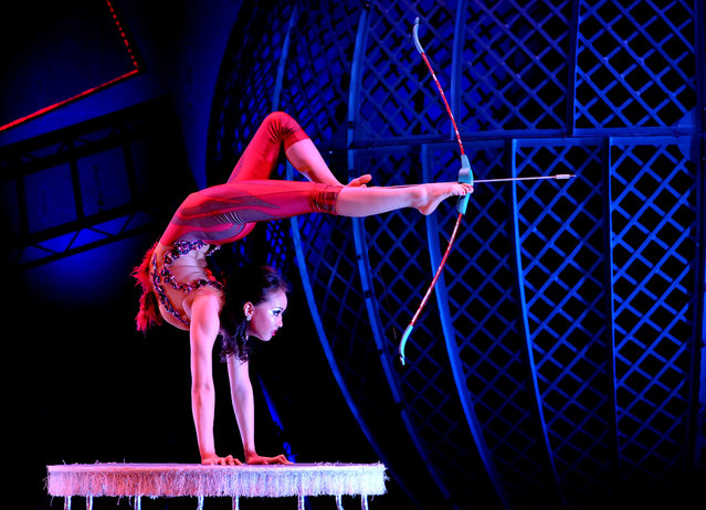 Contortionist Odka prepares to fire an arrow from a bow as she performs during a photo call for Zippos Cirque Berserk opening at the Peacock Theatre, central London, with an international cast of over 30 acrobats, jugglers, aerialists, drummers, dancers, clowns and stunt-men on February 8, 2016. (Photo by Nick Ansell/PA Wire via ZUMA Press)