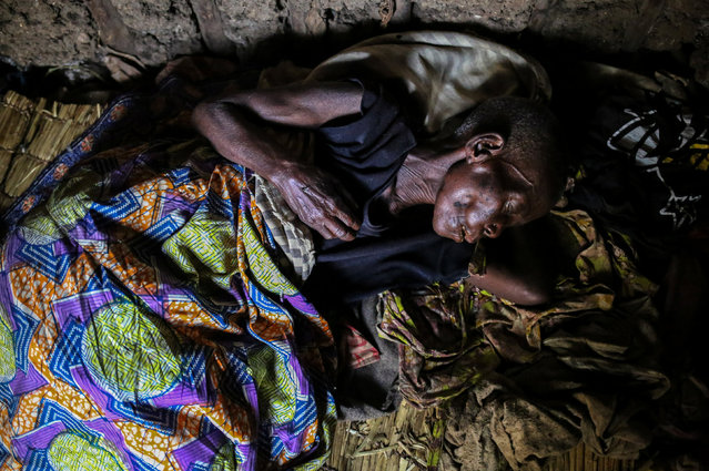 A woman, 60, who is suffering from malaria rests in her house at Kagorwa Pygmy camp on Idjwi island in the Democratic Republic of Congo, November 22, 2016. The woman died from her illness a few days later. (Photo by Therese Di Campo/Reuters)