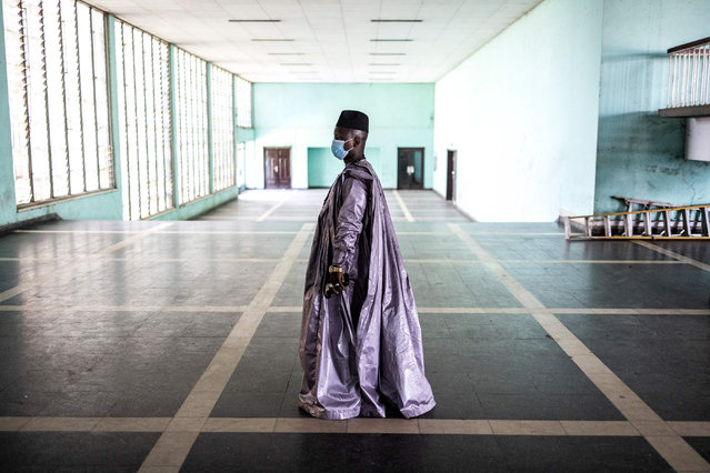 A religious leader arrives at the Peoples Palace ahead of the first session of talks with Colonel Mamady Doumbouya in Conakry on September 14, 2021. Colonel Mamady Doumbouya's special forces on September 5, 2021 seized Alpha Conde in a Coup, the West African state's 83-year-old president, a former champion of democracy accused of taking the path of authoritarianism. (Photo by John Wessels/AFP Photo)