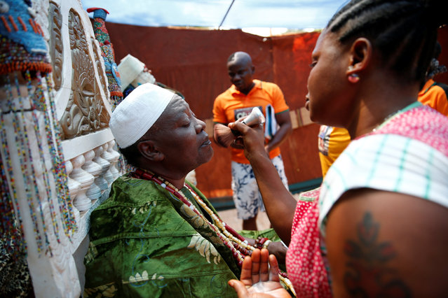 """A make-up artist applies powder on actor Adeyemi Oluyemi Lawrence before the rehearsal of a scene from the film titled """"Oluwo"""" at a film location in Ilase village, 125km outside Nigeria's commercial capital Lagos, January 15, 2017. (Photo by Akintunde Akinleye/Reuters)"""
