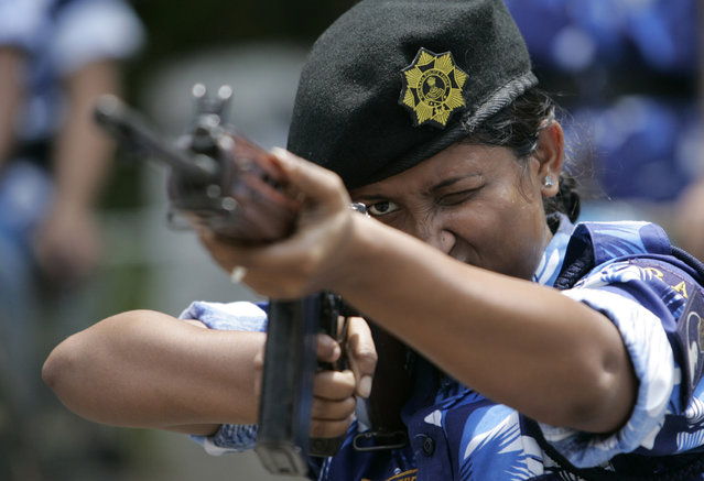 Mamoni Mandal, member of the Rapid Action Force (RAF), attends a training session at a police training school in Kolkata April 15, 2007. (Photo by Parth Sanyal/Reuters)