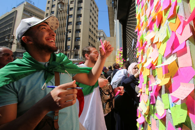 People write slogans and messages on sticky notes during a protest demanding immediate political change in Algiers, Algeria March 12, 2019. (Photo by Ramzi Boudina/Reuters)