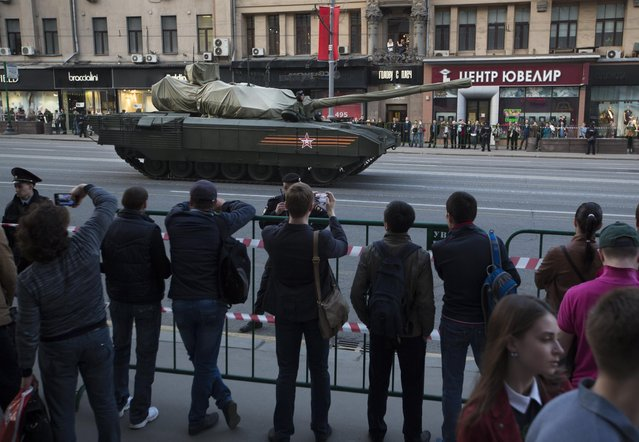 The Russian T-14 Armata tank, with its turret covered with fabric, makes its way to Red Square during a rehearsal for the Victory Day military parade which will take place at Moscow's Red Square on May 9 to celebrate 70 years after the victory in WWII, in Moscow, Russia, Wednesday, April 29, 2015. (Photo by Alexander Zemlianichenko/AP Photo)