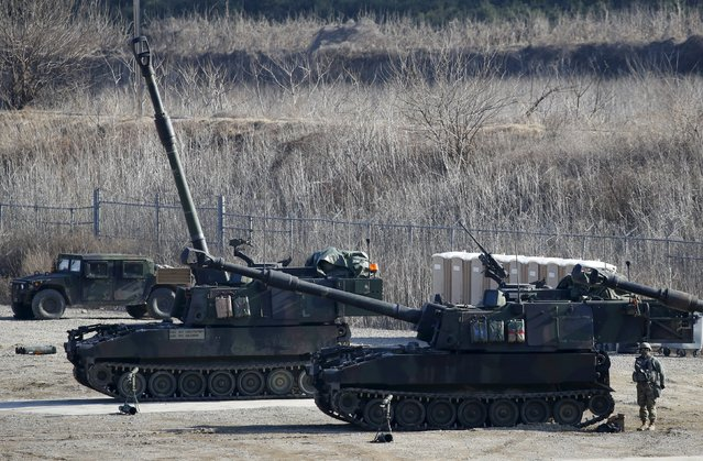 A U.S. Army soldier stands behind their M109A6 Paladin self-propelled howitzers during a military exercise in Pocheon, South Korea, March 10, 2016. (Photo by Kim Hong-Ji/Reuters)