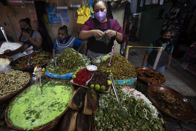 Crayfish, grasshoppers, and other local delicacies are displayed for sale at an eatery in the market of Xochimilco, Mexico City, Thursday, August 12, 2021, as Mexico City prepares for the 500th anniversary of the fall of the Aztec capital of Tenochtitlan. The canals and floating gardens of Xochimilco are the last remnants of a vast water transport system built by the Aztecs to serve their capital of Tenochtitlán. (Photo by Marco Ugarte/AP Photo)
