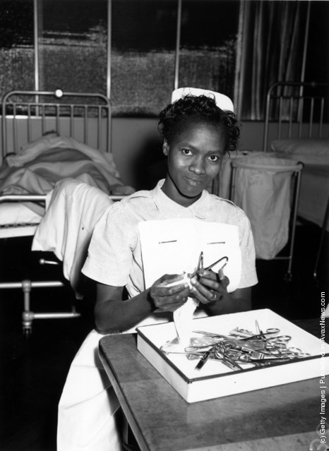 7th November 1958:  Christina Oyemaja from Nigeria cleaning surgical instruments in Brook General Hospital, Blackheath, London. She is one of the nurses from many different countries who are receiving training at the PTS (preliminary training school) of the Woolwich group of hospitals