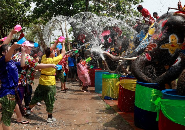 Elephants and people play with water as part of celebrations for the water festival of Songkran in Ayutthaya, Thailand on April 11, 2019. (Photo by Soe Zeya Tun/Reuters)