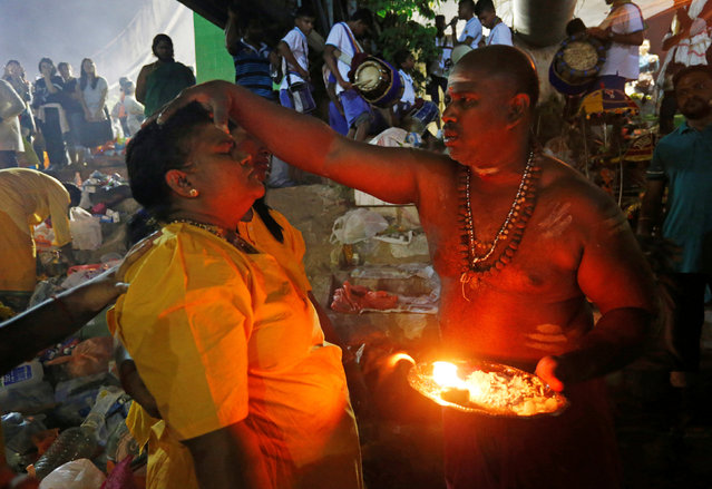 Devotees receive blessings in Batu Caves during the Hindu festival of Thaipusam in Kuala Lumpur, Malaysia February 9, 2017. (Photo by Lai Seng Sin/Reuters)